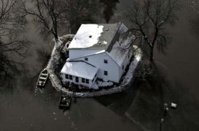 house-with-sandbag-levee