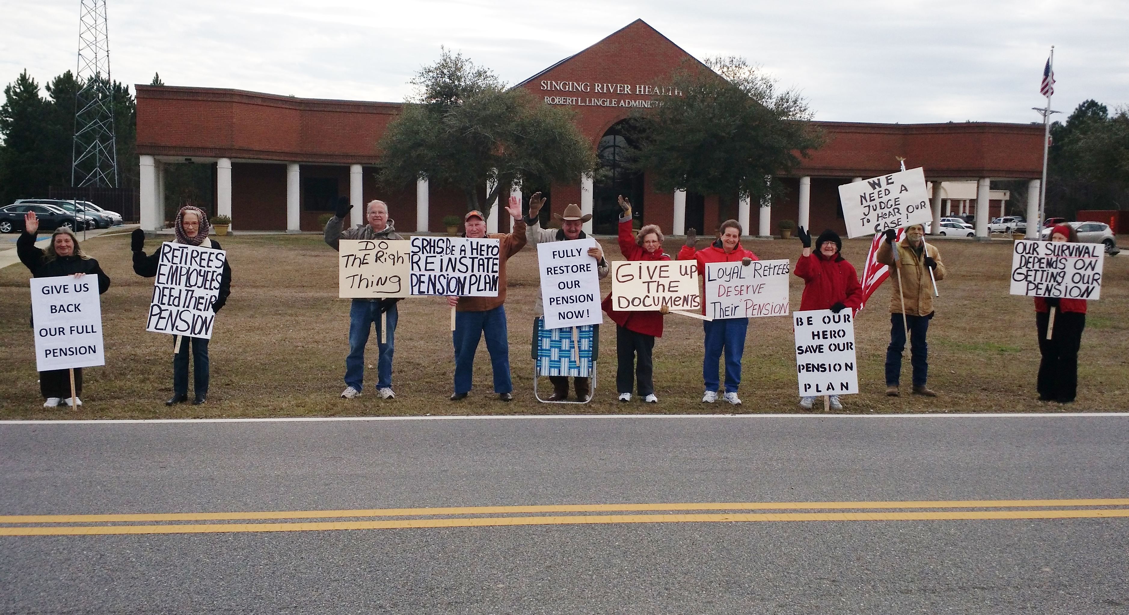 Reader Submitted Photo | SHRS Retirees Protest outside the SRHS Administrative Office Complex in Gautier (2/17/15)